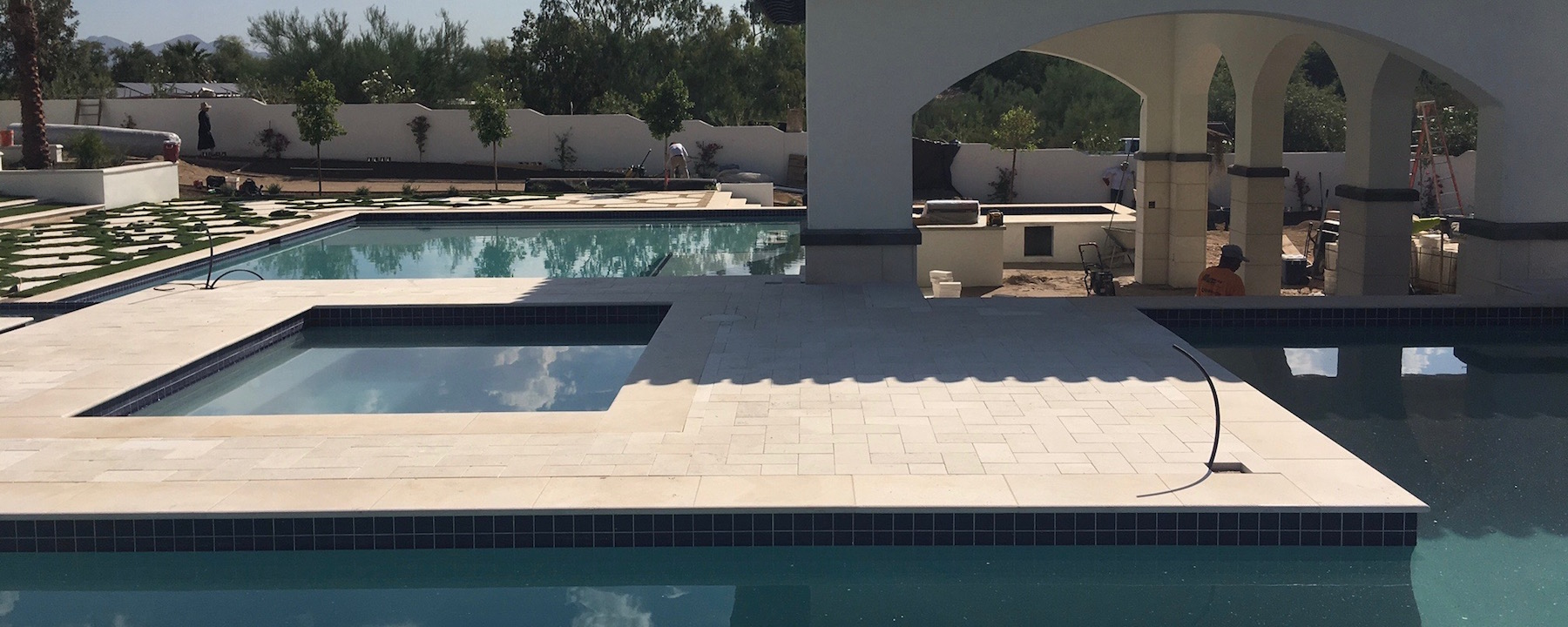 Pavers, Pool Coping, Custom Dark Color Design Accent on Columns, Wall Coping