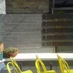 Exterior hardscape design | Fireplace Hearth in Restaurant Entertainment Area Outside | Joyride Taco Place