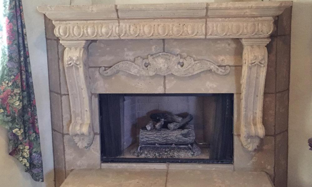 Custom Design of Fireplace using Mesa Precast Products | Architectural Trim - Large Egg and Dart Architectural Trim - Stavola Corbel legs - Catalog Ornamental Element: Cartouche