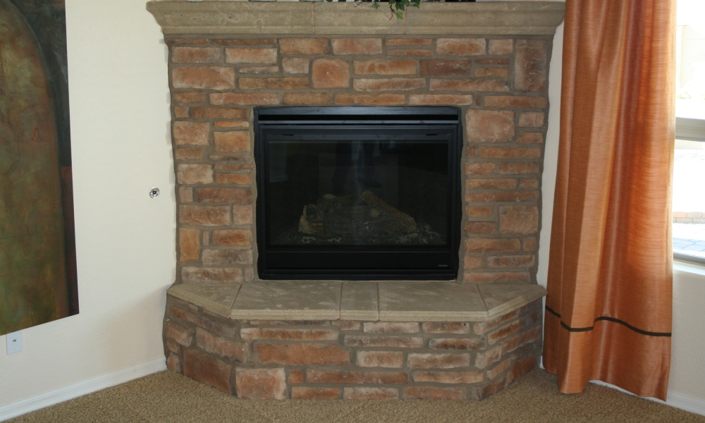 Fireplace | Precast Panels of Hearth and Mantle Contrasting with Brick