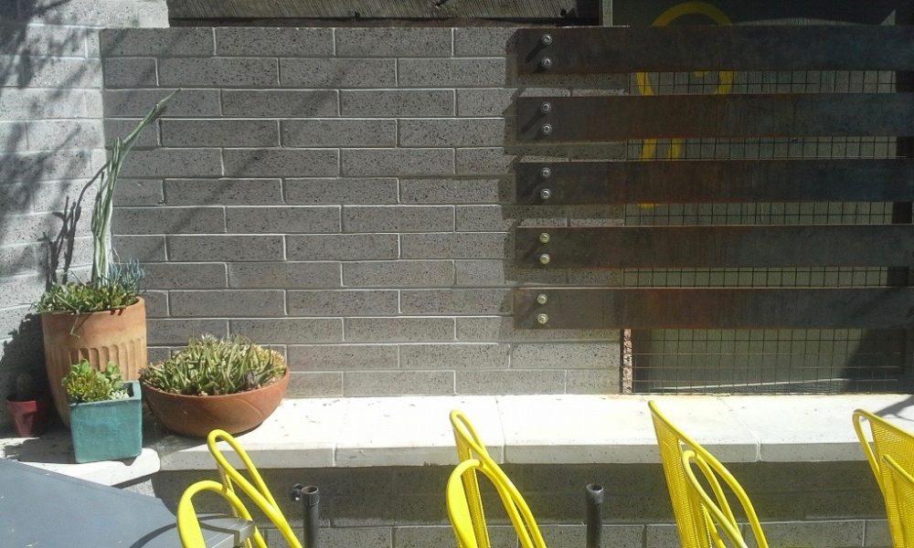 Exterior Hardscape Design | Fireplace Hearth in Restaurant Entertainment Area Outside Joyride Taco Place